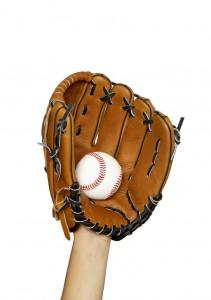 Hand in Baseball Glove Catching Ball