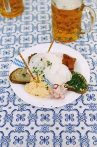 Plate with typical bavarian snacks and beer